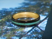 African Blackwood with a Maple liner and a crushed inlay band of Turquoise