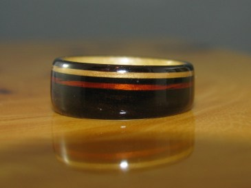 African Blackwood with a Pine liner and Dark Cherry and Light Oak Offset Bands