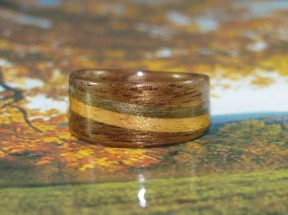 Chocolate Walnut ring with a band of Maple and a slightly larger band of Birch