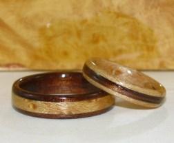 Contrasting wedding bands of Bird's Eye Maple and Dark Hawaiian Koa