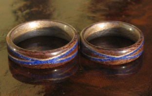 Dark Walnut rings with greyed Maple liners and cross spiralled bands of Greyed Maple and Lapis