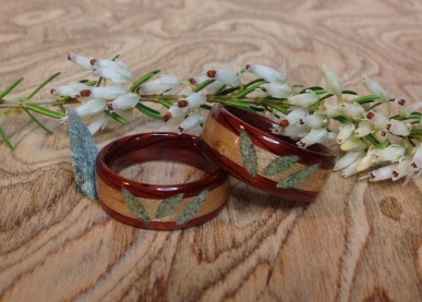 Dark Cherry rings with Bird's Eye Maple inlays and hand carved Jade leaves