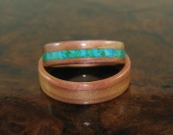 Juniper Heartwood wedding rings, hers has a Malachite and Turquoise band