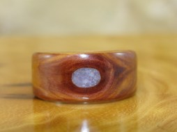 Juniper Heartwood ring with the knot of the wood filled with Amethyst
