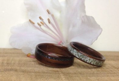 These Rosewood wedding bands are a beautiful display of his and hers rings. They both have Abalone shell which was found on Gabriola Island, BC. With a thinner offset band with Lava Rock mixed in the ring became more subtle and masculine. By adding Mother of Pearl and Howlite to her ring it gave it the air of femininity.